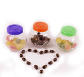 Three Jars with candies and chocolate heart Stock Photo