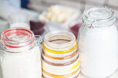 Three jars with the flour in the kitchen Stock Photos