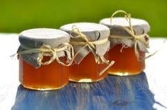 Three jars full of delicious fresh honey Stock Photography