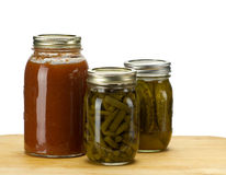 Three jars of homemade canned produce Royalty Free Stock Image