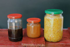 Three jars. With homemade products Royalty Free Stock Photos