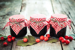Three jars of jam and hawthorn berries on  table Royalty Free Stock Image
