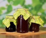 Three jars of jam on table Royalty Free Stock Photos