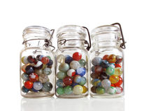 Three jars of marbles Stock Image