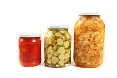 Three jars of pickled vegetables Stock Photos
