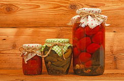 Three jars of pickles over vintage wood Stock Image