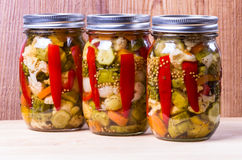 Three jars of preserved mixed vegetables Stock Photo
