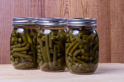 Three jars of preserved pickled beans Stock Photos