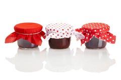 Three jars of red jam Stock Image