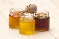 Three jars of sweet honey royalty free stock photos