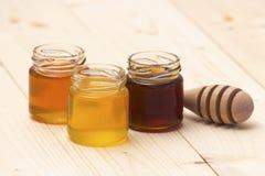 Three jars of sweet honey royalty free stock image