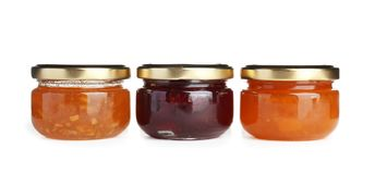Three jars with tasty sweet jam Royalty Free Stock Image