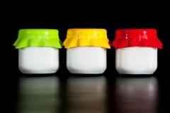 Three jars of yogurt Royalty Free Stock Photography