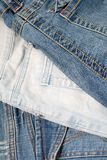 Three of jeans. Different colors Royalty Free Stock Photo