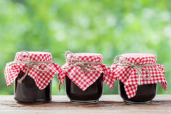 Three jears of jam on  table. Stock Image