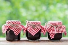 Three jears of jam on  table. Stock Image