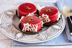 Three jelly tarts on plate Stock Images