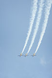 Three jet airplanes performing aerobatic stunt Stock Images
