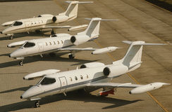 Three jet plains at airport elevated view Royalty Free Stock Photo