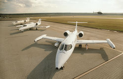 Three jet plains at airport helicopter in background elevated view Royalty Free Stock Photography