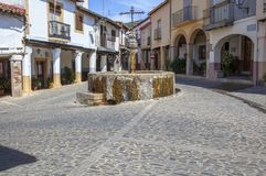 Three jets fountain square. Guadalupe, Spain. Guadalupe, Spain - September 3th, 2017: Three jets fountain square placed at old town . Caceres, Extremadura, Spain Royalty Free Stock Image