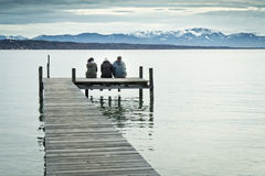 Three at the jetty Royalty Free Stock Photos