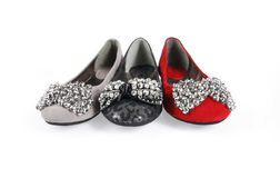 Three jeweled flat shoes. On a white background royalty free stock photography