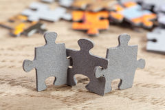 Three Jigsaw Puzzle Pieces on Table Royalty Free Stock Images
