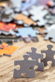 Three Jigsaw Puzzle Pieces on Table Royalty Free Stock Photography