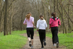 Three joggers Stock Images