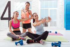 Three joyful women making selfie after training Stock Photos