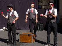 Three jugglers in the street. Royalty Free Stock Images