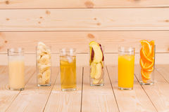 Three juices orange apple banana on wood. Stock Image
