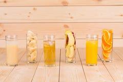 Three juices orange apple banana on wood. Stock Image