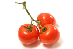 Three juicy tomatoes. On isolated background Stock Photo