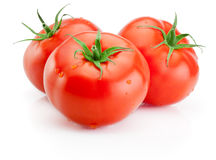 Three Juicy wet tomatoes isolated on white background Royalty Free Stock Photography