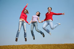 Three jumping girls Stock Photo