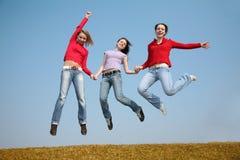Three jumping girls stock photo