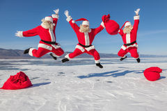 Three Jumping Santa Claus outdoors Royalty Free Stock Photo