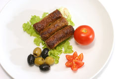 Three kabob with olives and tomatoes Stock Images