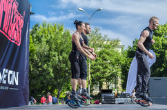 Three kangoo fitness instructors. Jumping and doing exercise on scene outdoor on May 18, 2014 in Bucharest Royalty Free Stock Image