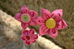 Three kanzashi fabric flowers Stock Images