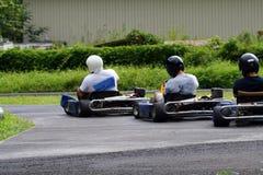 Three kartings. Three kart pilots racing royalty free stock images