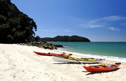 Three kayaks in Abel Tasman National Park, New Zealand. This image was shot on the Abel Tasman Trek, within the Abel Tasman National Park near Nelson, New Stock Images