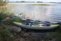 Three kayaks on the bank of Vuoksa. Stock Images