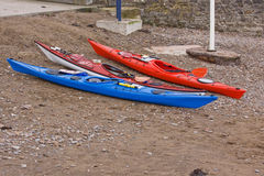 Three Kayaks on the Beach Royalty Free Stock Photo