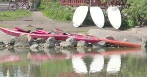 Three kayaks on the rocks 4K FS700 Odyssey 7Q stock video