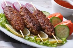 Three kebab of minced meat and fresh vegetables Stock Photo