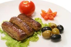 Three kebab rolls on dish Stock Image