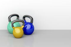 Three kettlebells Stock Images
